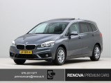 BMW 2 Serie Gran Tourer 218i Essential | Sportstoelen | Head-up display | Panoramadak | Navigatie Plus |